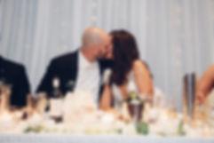1927 - Kiss on bridal table.jpg