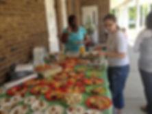 Montessori of Camden staff serving food