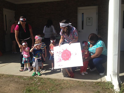 Montessori of Camden Toddlers outside with teachers