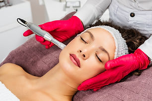 Beautiful woman receiving microneedling