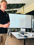 This is and image of Matt Vance Psychologist, Clinical Hypnotherapist giving a presentation in the Sunshine Coast Hinterland about Quit Smoking,Anxiety, and Stress Management. (Karen Poole LUXE Social Media photograph)