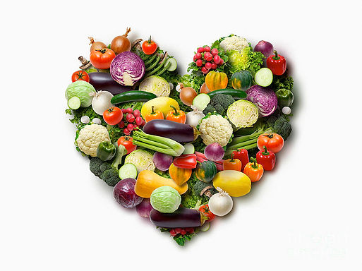 vegetables-arranged-in-heart-shape-on-wh