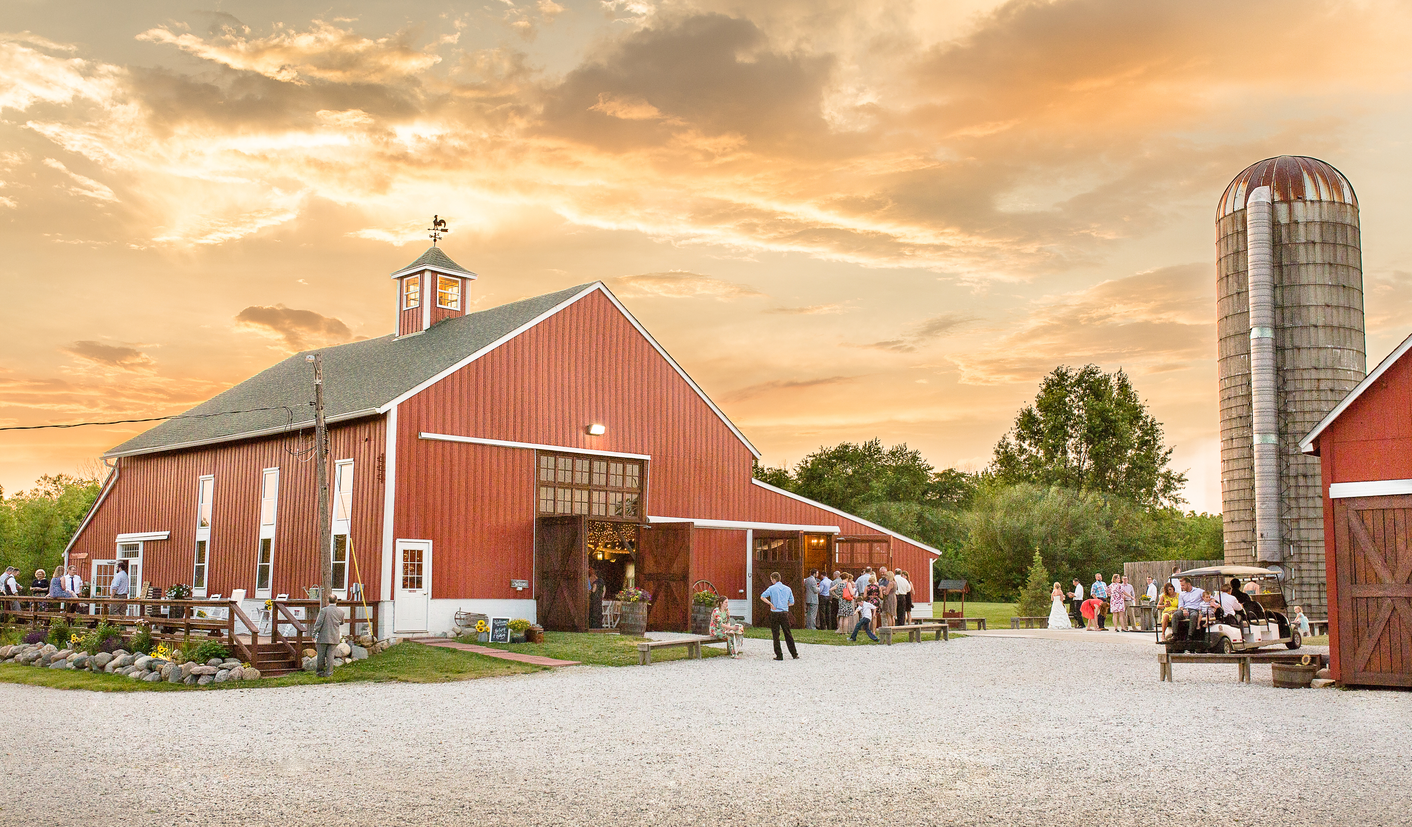 SE view of Avon Wedding barn at dusk during a reception