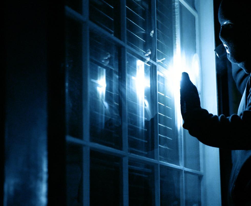 robber looking in window.jpg
