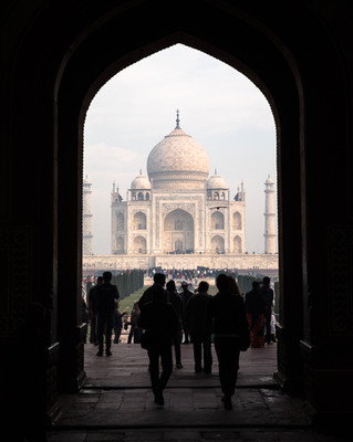 Tourists flock to the Taj Mahal shortly after sunrise.