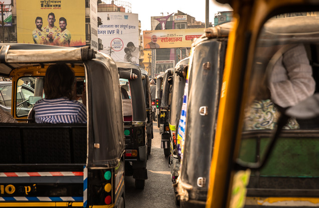 Dozens of auto rickshaws stopped in traffic in Udaipur, India.