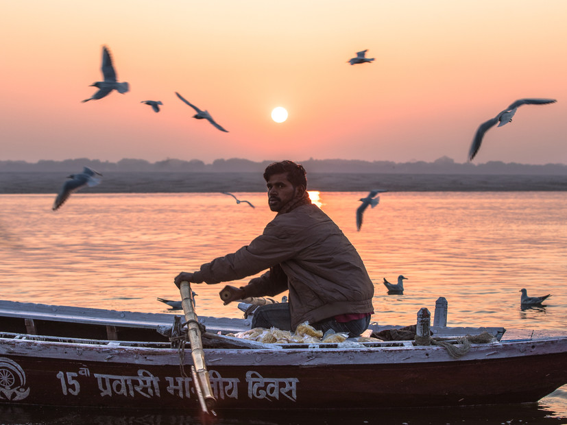 Sunrise on the Ganges River, and a man I'll never see again. I was photographing birds on my long lens when he drifted into my frame, and within seconds he was gone. When you visit a country like India, it's impossible not to come back with dozens of portraits shot on the fly.