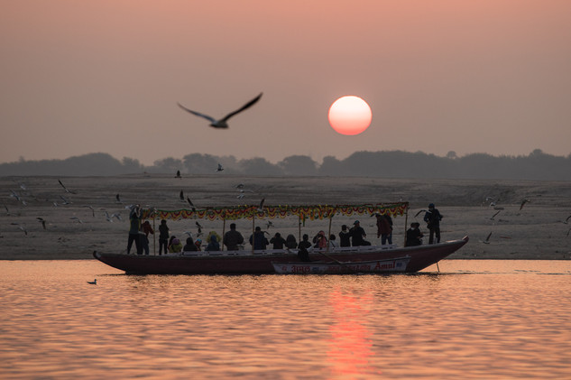 Sunrise along the banks of the Ganges River in Varanasi.