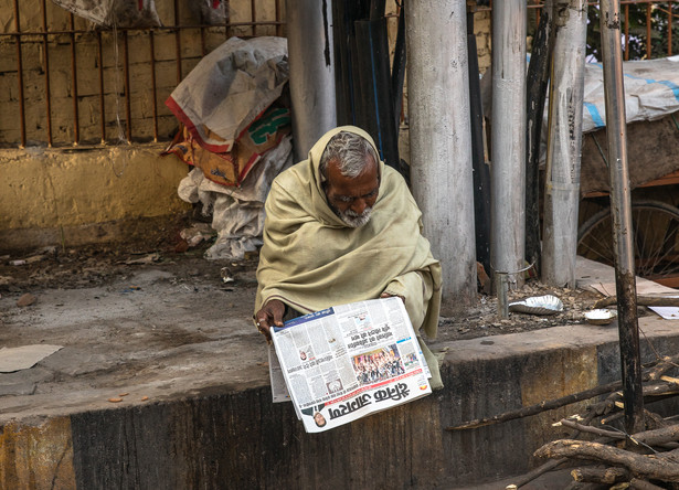 A man reads the newspaper in Agra, India.