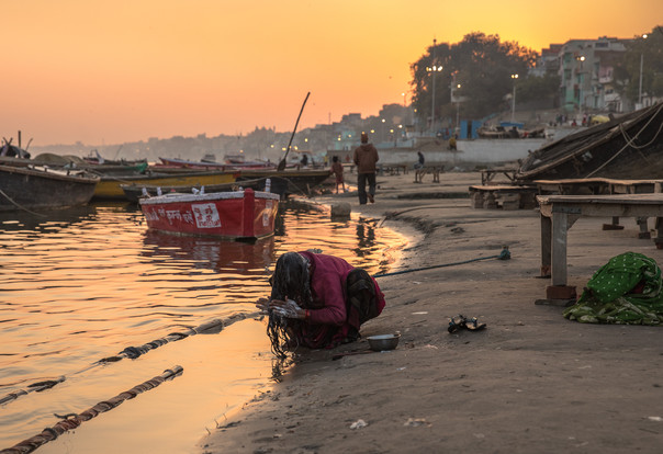 A woman washes her hair in the Ganges, one of the most polluted rivers in the world. Six billion liters of raw sewage and industrial waste dumped in the river every day.