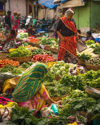 Scenes from a produce market in Udaipur.