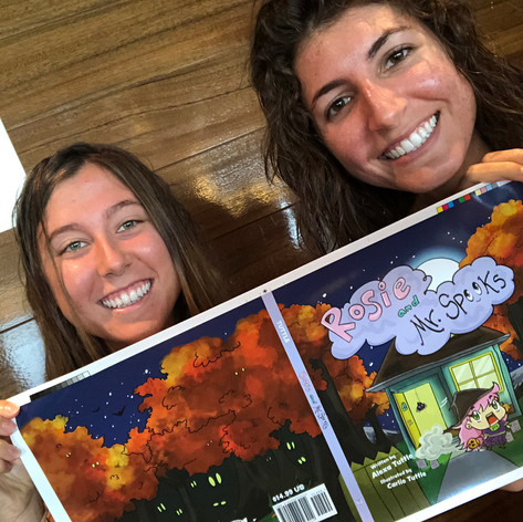 "My sister, Carlie, and I proudly holding our ""Rosie and Mr. Spooks"" cover print proof!"
