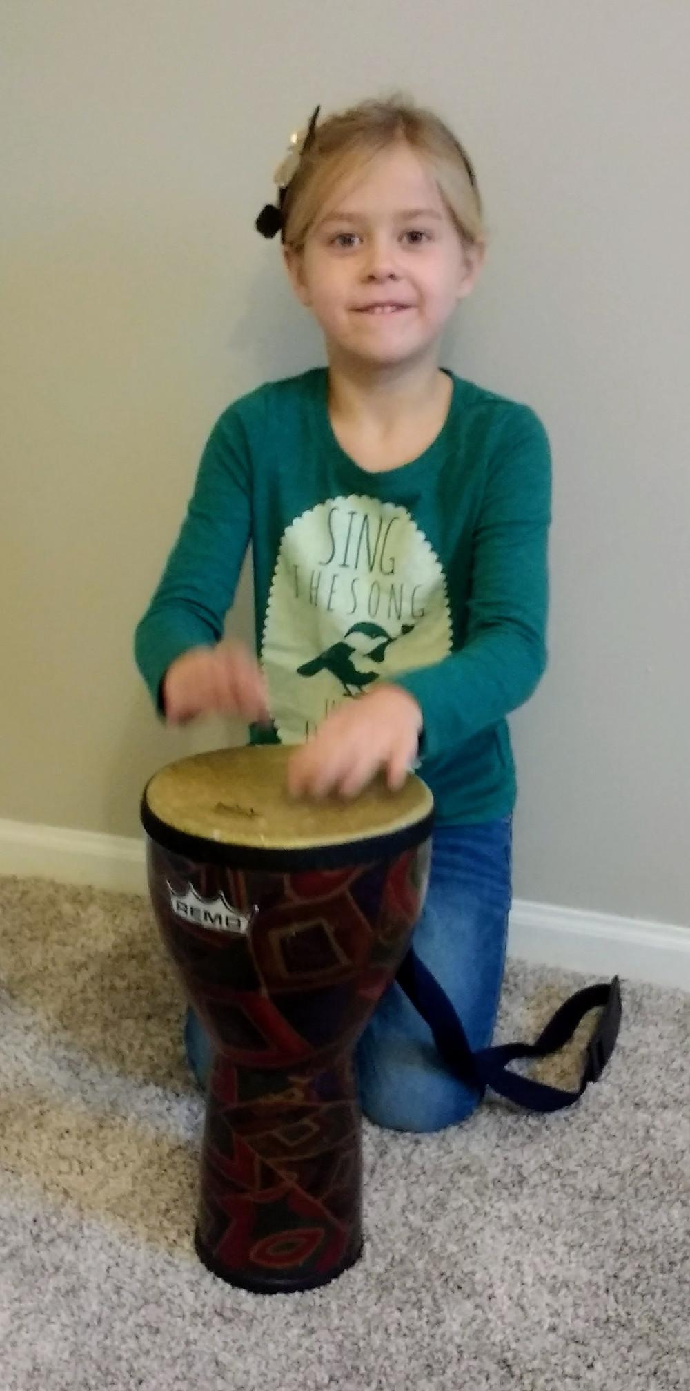 child playing drum