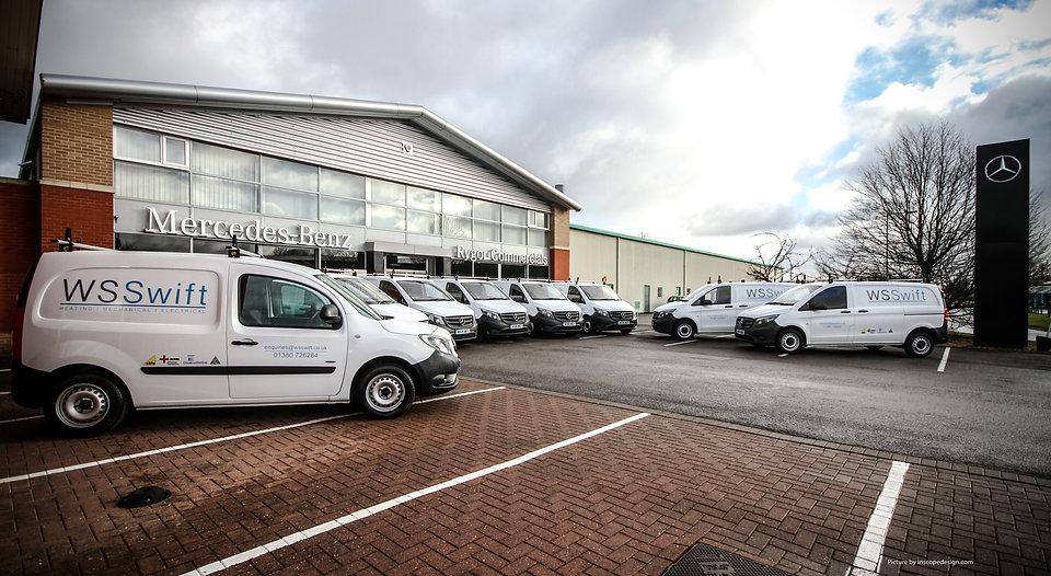 vans lined up in garage