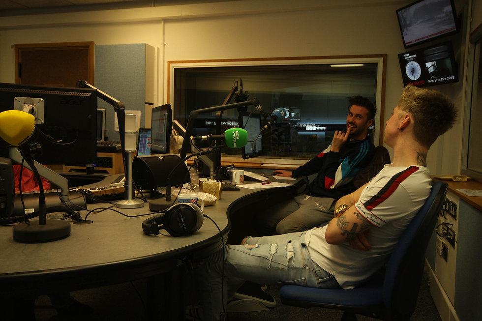 people chatting in radio studio