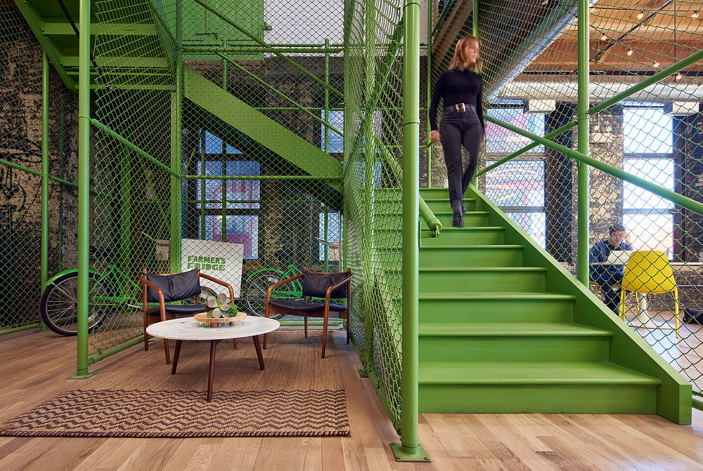 Branded green feature stair with chain link enclosure for Farmer's Fridge startup office in Near West Side, Chicago | Kuchar