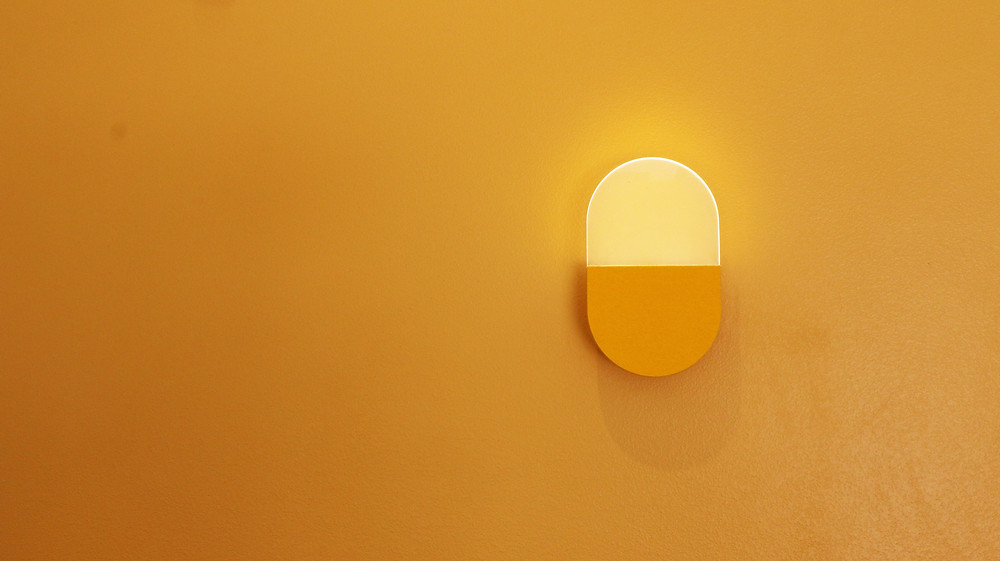 Wall sconce on a yellow accent all