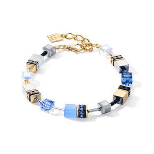 funkelnden Swarovski® Kristallen, goldenem Edelstahl und synthetischem Tigerauge verbindet dieses Armband aus der berühmten GeoCUBE® Kollektion sonnige Goldtöne mit strahlenden Blaunuancen.