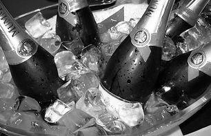 Bottles of G.H. Mumm in ice bucket