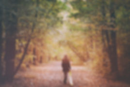 woman walking in the woods