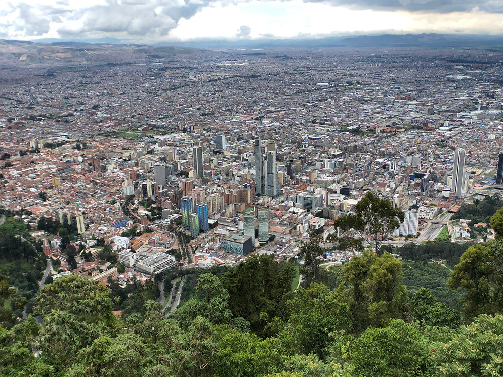 At the top of the highest mountain of Bogota, the Monserrate sight view at 3160 meters of altitude. The city has grown as a triangle and now is a vastly populated urban environment.