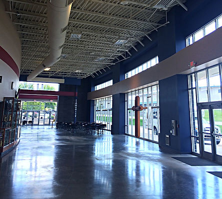St. Dominic High School Gym and Performing Arts Center lobby along window wall. DE|SL LLC