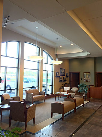 The Bank of Old Monroe bright and comfortable lobby and lounge area with large windows. DE|SL LLC