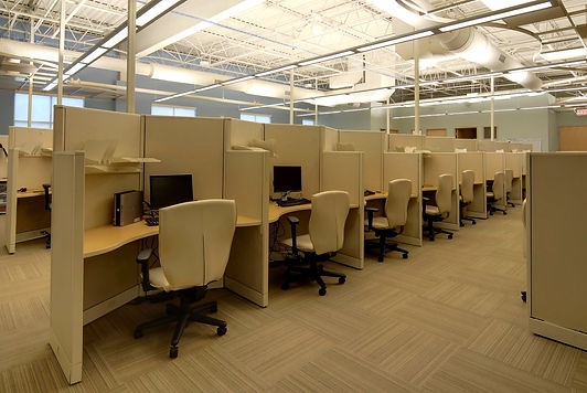 Outdated outlet mallis renovated to provide corporate offices and call center for national company. DE|SL LLC