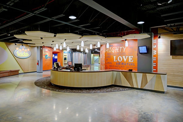 Grace Church St. Louis newly themed children's space with centrally positioned check-in and secure control visibility provides help and information to visitors and parents for easy wayfinding and circulation throughtout the large ministry area. DE|SL LLC