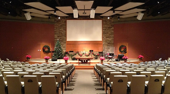New Covenant/Faith Church sanctuary space with acoustic ceiling treatment, baptistery and stone wall feature. DE|SL LLC
