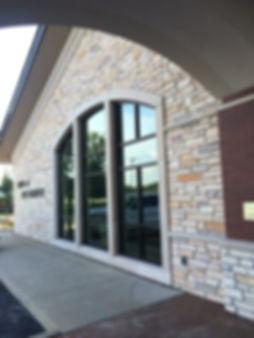 DE|SL Bank of Old Monroe Operations Center entrance and window wall. DE|SL LLC