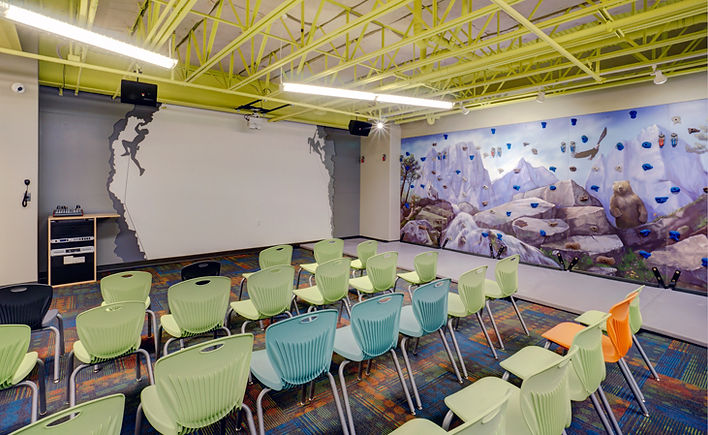 Grace Church STL themed children's classroom with rock climbing activity and feature walls. DE|SL LLC