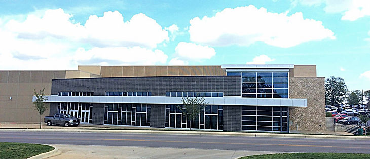 St. Dominic High School Gym and Performing Arts Center exterior view of main lobby with masony, stone, glass and prefabricated structural insulated concrete exterior wall panels. DE SL LLC