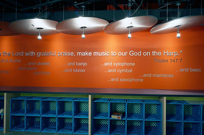 Grace Church STL children's ministry Biblically based feature wall and student's personal storage system. DE|SL LLC