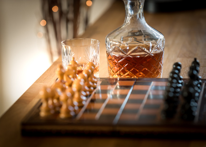 Chessboard and whisky decanter