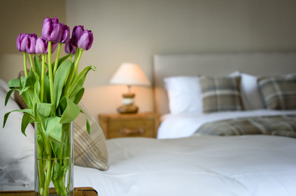 Hotel bedroom with flowers