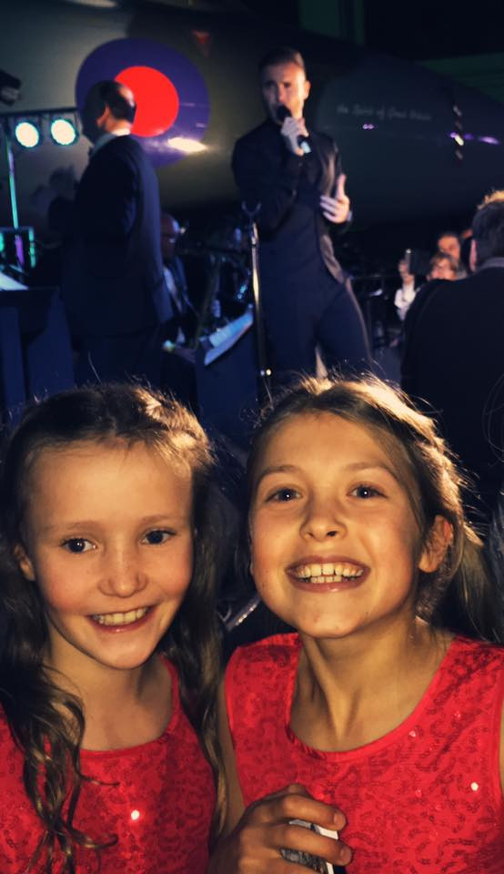 Lily and Tiny enjoying Gary Barlow's set!