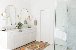 Bathroom Design using marble tile, brass