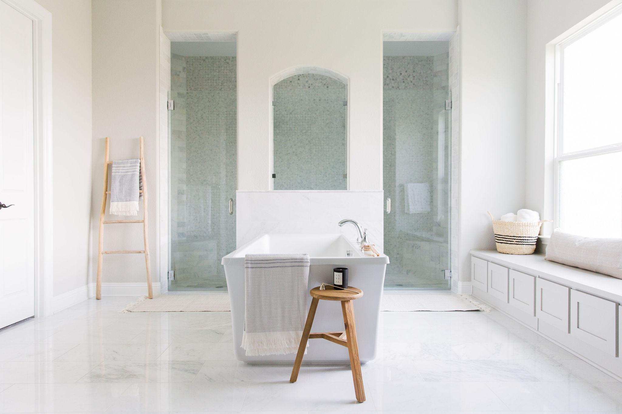 Bathroom design using marble tiles, wood