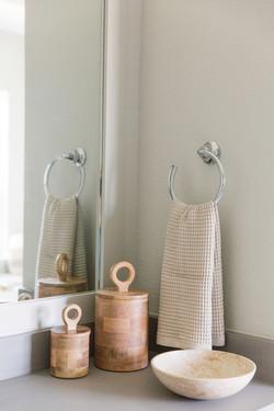 Bathroom design using wood canisters, ma