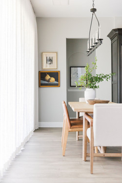 Dining Nook with white linen drapes, vin