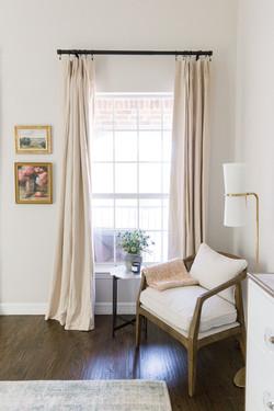 White and brass dresser, linen drapes, b