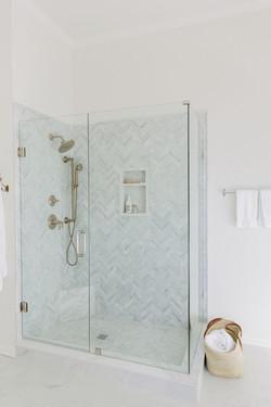 Marble herringbone shower design by Laur