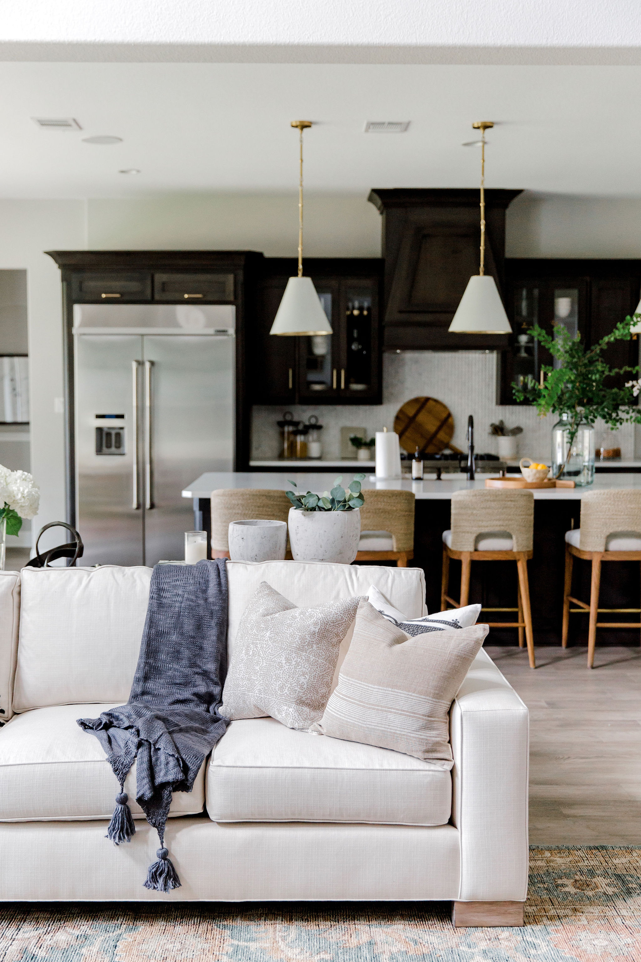 Kitchen design with brass pendants, seag
