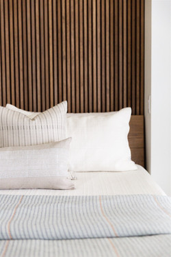 Primary bedroom design featuring reeded