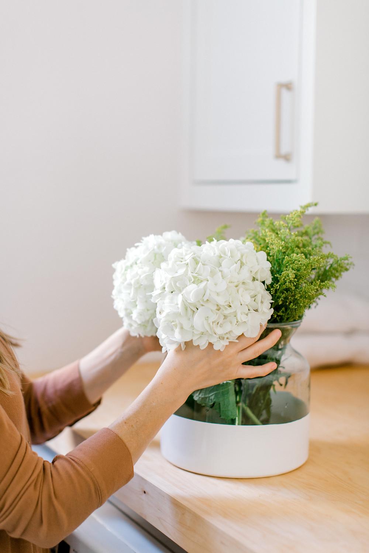 White dipped vase, kitchen design by Laura Design and Co, Dallas interior designer