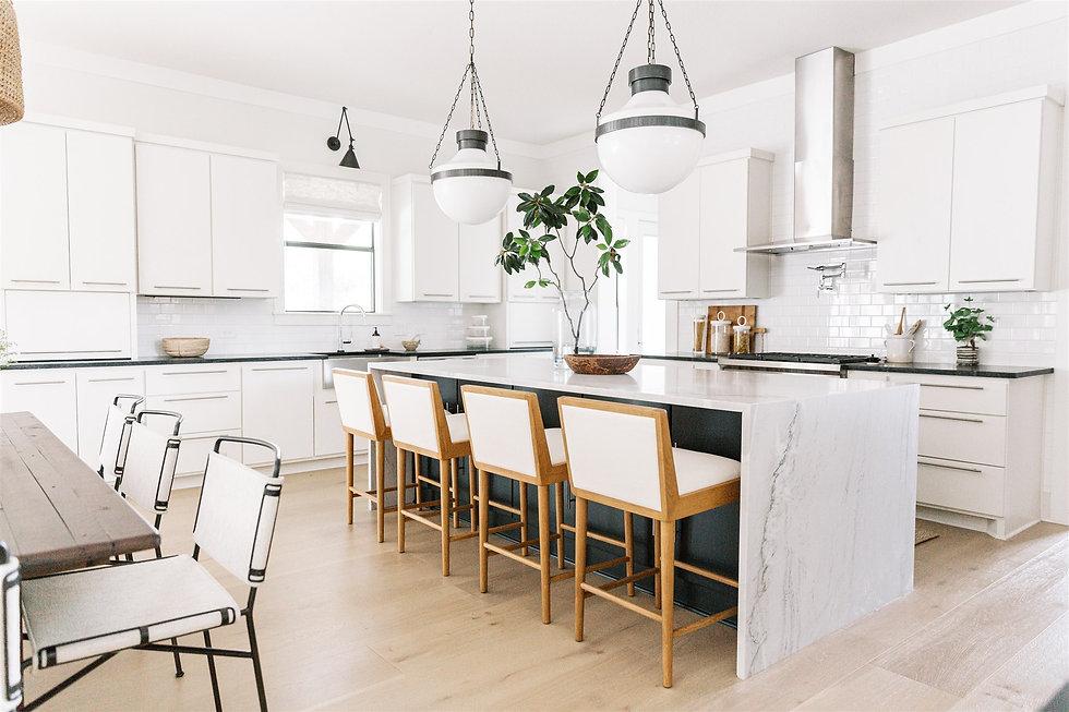 Kitchen design featuring quartzite counter tops, soapstone countertops & decor by Laura De