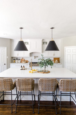 White kitchen design by Laura Design & C