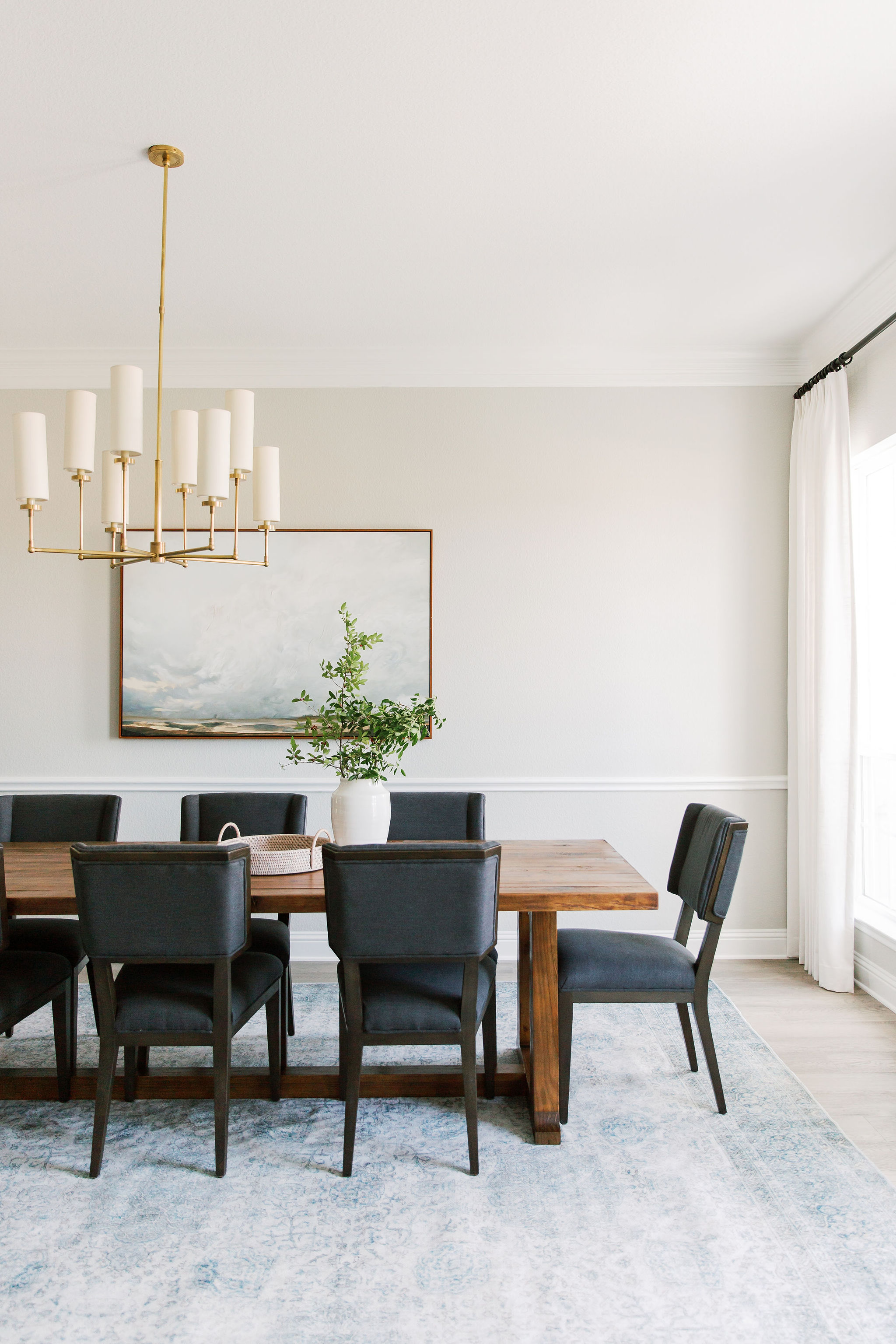Dining room design with oversized artwor