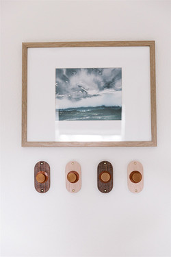 Wooden hooks and landscape print by Laura Design and Co, Dallas interior designer